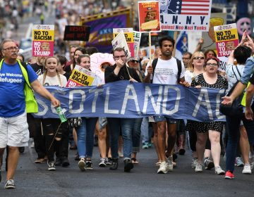 People in Edinburgh, Scotland, march in protest against President Trump during his first official visit to the U.K. (Jeff J. Mitchell/Getty Images)