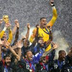 France players lift the World Cup trophy after their victory in the 2018 FIFA World Cup Final between France and Croatia in Moscow on Sunday. (Chris Brunskill/Fantasista/Getty Images)