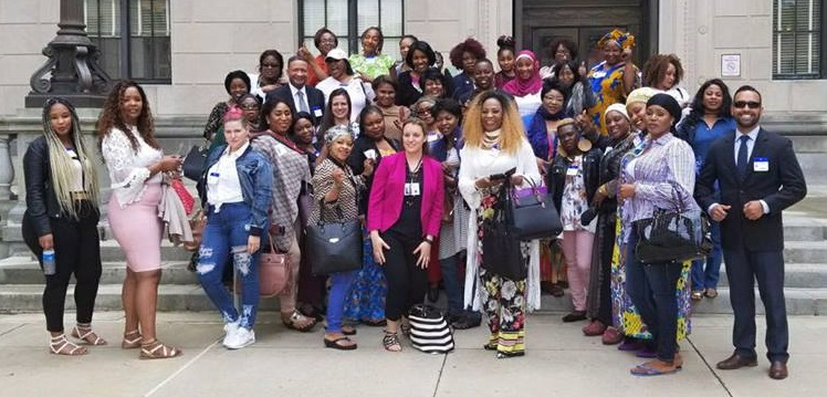 The New Jersey Hair Braiding Freedom Coalition assembles outside the the State House in Trenton before a committee hearing in May. (Courtesy of Brooke Fallon)
