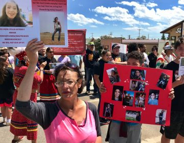 Loxie Loring walks with a group of marchers to remember her daughter, Ashley Loring, who went missing from the Blackfeet Reservation more than a year ago. (Nate Hegyi/Yellowstone Public Radio)