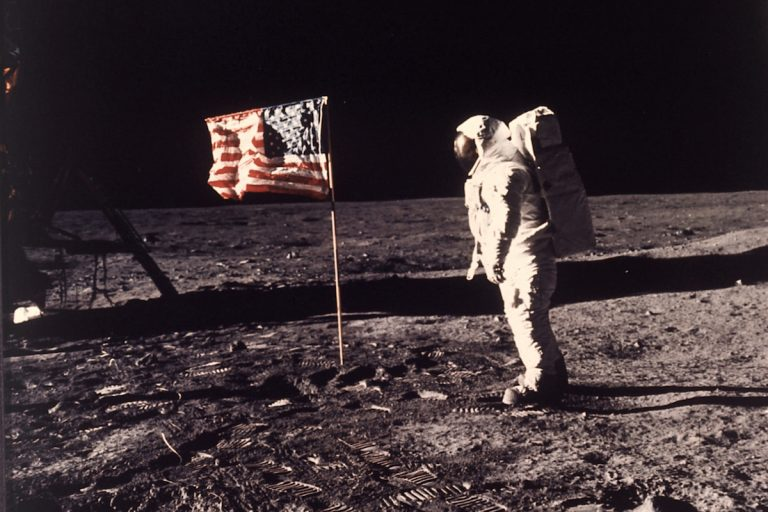 SPACE EXPLORATION, APOLLO 11 MISSION, FIRST  MAN TO LAND ON MOON, WALK ON MOON, AMERICAN ASTRONAUT WITH U.S. FLAG, SPACE SUIT, LUNAR SURFACE, FOOTPRINTS, CENTURY SHOWCASE