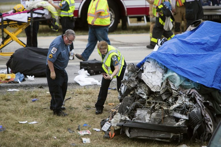 Paramedics work the scene of a deadly car crash on Route 1 near Townsend, Del., Friday, July 6, 2018. (Suchat Pederson/AP)