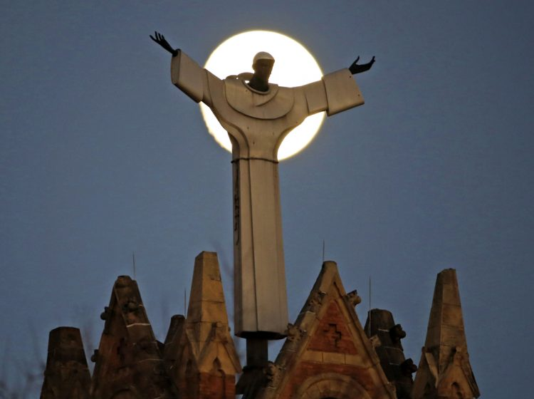 The moon rises behind St. Benedict The Moor Catholic church in Pittsburgh Saturday, Nov. 12, 2016. Pittsburgh is one of six Roman Catholic Dioceses that was the focus of a sealed grand jury investigation across Pennsylvania. (AP Photo/Gene J. Puskar)