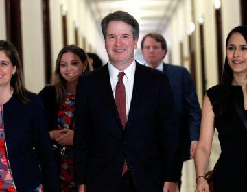 Supreme Court nominee Judge Brett Kavanaugh, center, arrives for a meeting with Sen. Jim Inhofe, R-Okla., Thursday, July 26, 2018, on Capitol Hill in Washington. (AP Photo/Jacquelyn Martin)