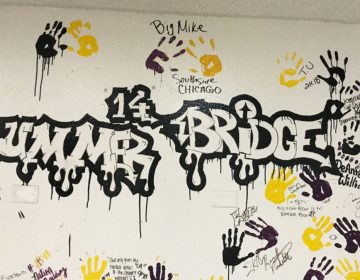 Participants from the college's Summer Bridge program traditionally leave their mark on campus in the school colors of black, purple and gold. (Delece Smith-Barrow/ The Hechinger Report)