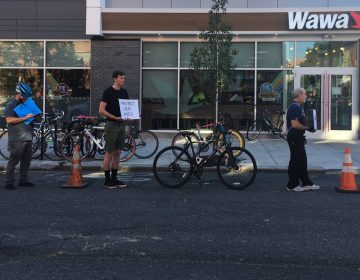 Customers often park in the bike lane while they run into the Wawa on 22nd Street, which opened a few months ago. (Jim Saksa/WHYY News)