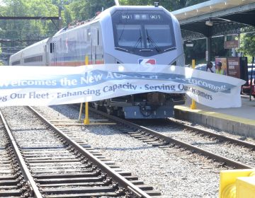 One of the new SEPTA locomotives pulls into the Chestnut Hill station. (Tom MacDonald/WHYY)