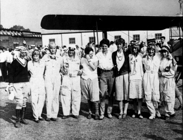 """Competitors in East St. Louis at the first-ever women's air derby. From left to right: Mary Elizabeth von Mach, Jessie """"Chubbie"""" Miller, Gladys O'Donnell, Thea Rasche, Phoebe Omlie, Louise Thaden, Amelia Earhart, Blanche Noyes, Ruth Elder and Vera Walker."""