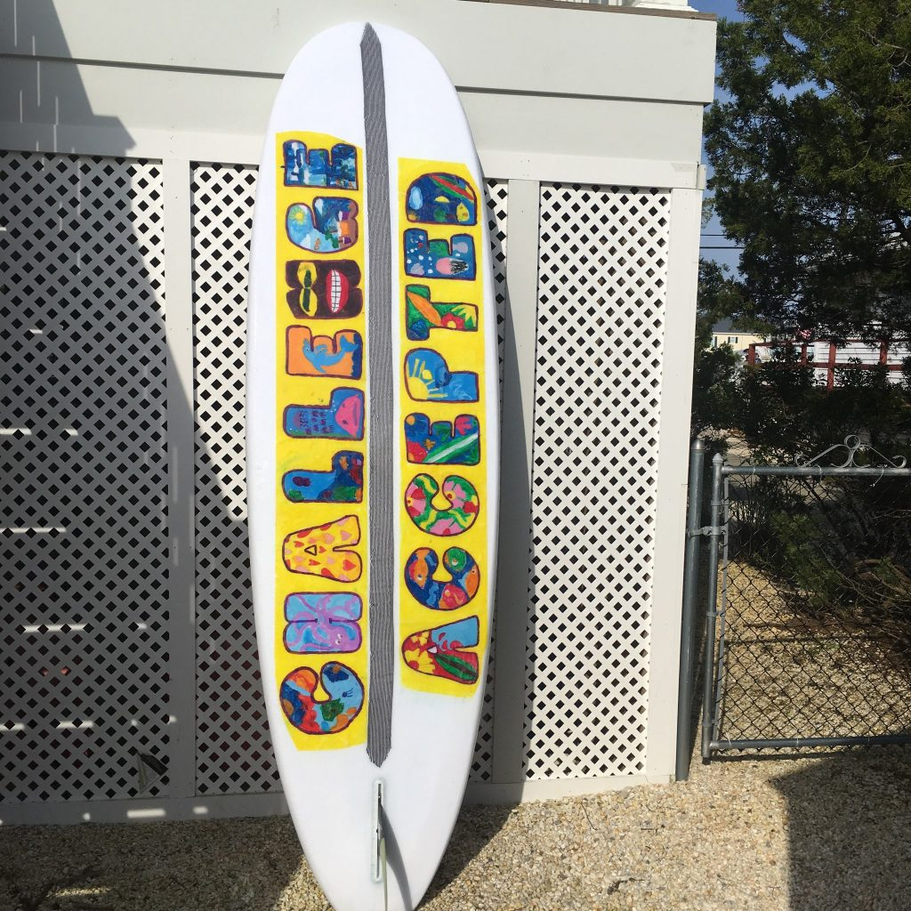 An adaptive surfboard designed/donated to MossRehab by surfboard shaper Luke Alvaraze with artwork designed by the students with disabilities at Carusi Middle School. Photo Credit: Alex Felts and Chelsea Bronstein
