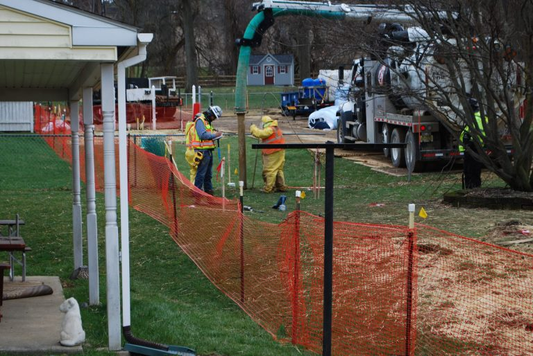 In this file photo from May, pipeline workers probe the ground on Lisa Drive in West Whiteland Township where sinkholes have developed as a result of the Mariner East 2 construction. (Jon Hurdle/StateImpact Pennsylvania)