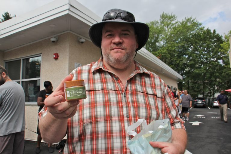 Thom ?? holds a container of dry-leaf marijuana, which was made available for sale at dispensaries in Pennsylvania for the first time. About 50 people lined up outside TerraVida Holistic Centers in Abington hours before the dispensary opened at 10 a.m.