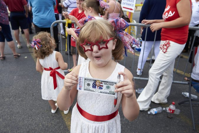 Savannah Corcoran, 6, from Plains, Pa., at the Make America Great Again rally dressed in patriotic garb, which she found earlier that day at Joann Fabric. (Natalie Piserchio for WHYY)