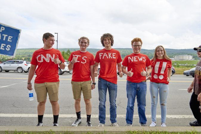 A group of college students from Bloomsburg University in Wilkes-Barre, Pa., on August 2, 2018 for the Make America Great Again rally. (From left) Butch Whitmer, David Whitmer, Matthew Gummo, Bryce, and Natalie (Natalie Piserchio for WHYY)
