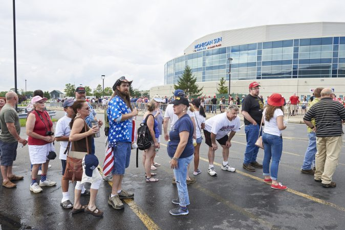 Trump supporters line up outside of the Mohegan Sun Arena in Wilkes-Barre, PA, on August 2, 2018 for the Make America Great Again rally where President Trump will headline. Trump is making a visit to endorse Lou Barletta, who is campaigning to unseat Senator Bob Casey. (Natalie Piserchio for WHYY)