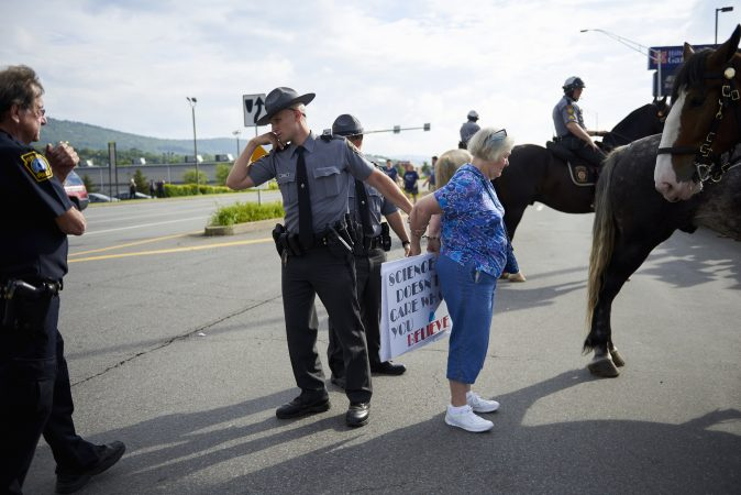 An arrest was made outside at an Anti-Trump demonstration on Highland Park Boulevard, outside of the Make America Great Again rally on August 2, 2018. (Natalie Piserchio for WHYY)
