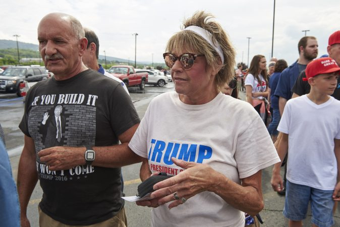Janice Ashman, from Brandonville, Pa., stands next to her husband, John Ashman, in anticipation for the Make America Great Again Rally in Wilkes-Barre, Pa., on August 2, 2018. (Natalie Piserchio for WHYY)