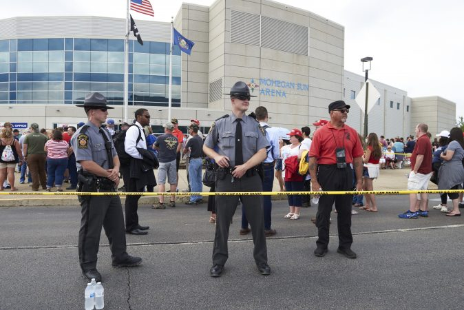 Police stand on guard on August 2, 2018, outside of the Make America Great Again rally, where President Trump will headline.  (Natalie Piserchio for WHYY)
