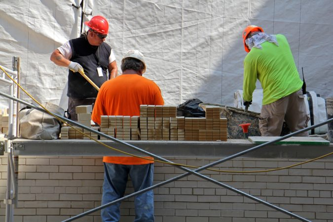 Brick repair at the North Light Court at 30th Street Station. (Emma Lee/WHYY)