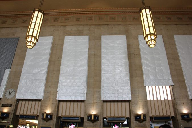 The soaring windows at 30th Street Station undergoing restoration. (Emma Lee/WHYY)