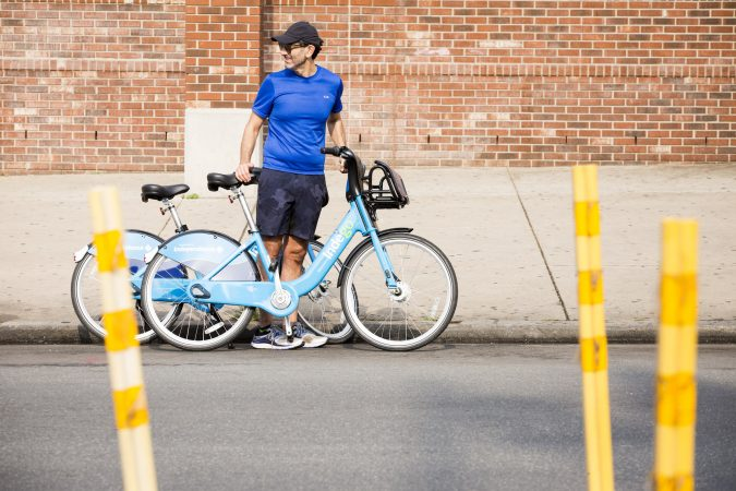 Eric Neuhaus prepares to go for a bike ride down Broad Street during the Philly Free Streets event on August 11, 2018. He says that the event is
