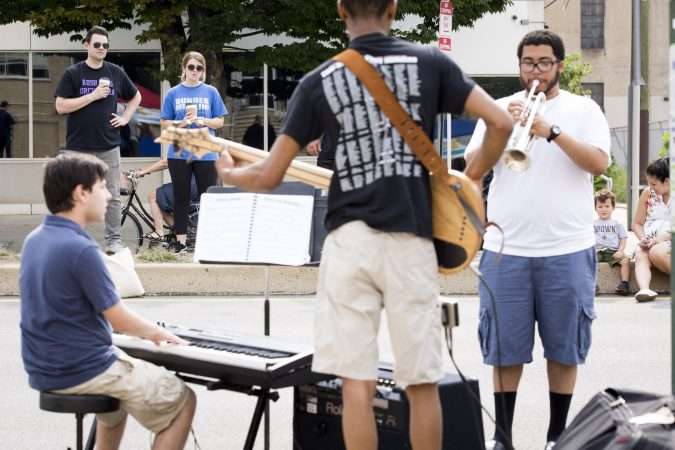 Passersby stop at the median in front of the Philadelphia School District building to watch a jazz band perform during Philly Free Streets on August 11, 2018. (Rachel Wisniewski for WHYY)