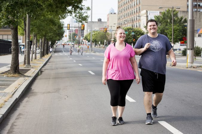 Lynne Silverstein (left) and Peter Zoltowski go for a walk down Broad Street on August 11, 2018. Silverstein says