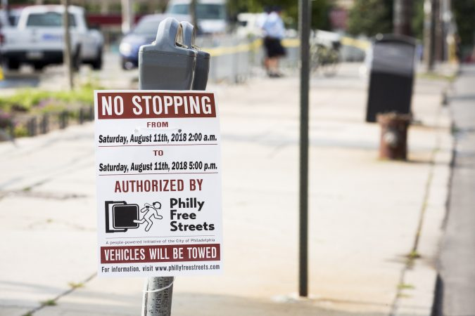 A sign on a parking meter advertises that there will be no stopping in honor of the Philly Free Streets event which closed down Broad Street to cars from City Hall to Germantown Avenue on August 11, 2018. (Rachel Wisniewski for WHYY)