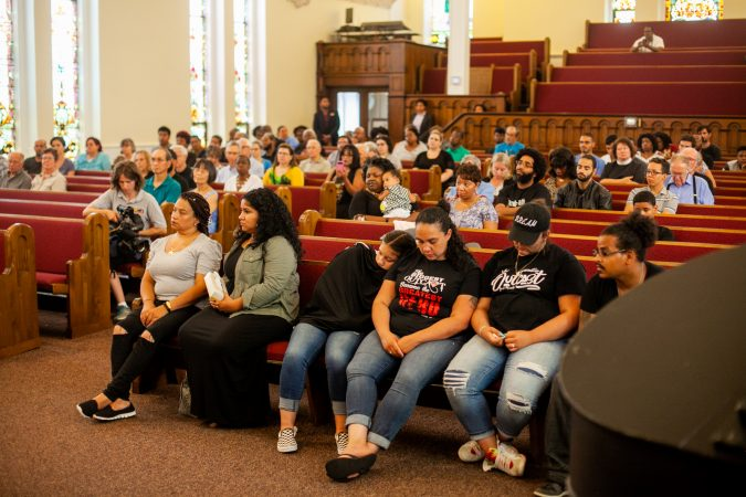 The family of Joseph Santos listens to speakers at a memorial service for the 44-year-old who was fatally shot on July 28, 2018 by South Whitehall Township Police Officer Jonathan Roselle. (Brad Larrison for WHYY)