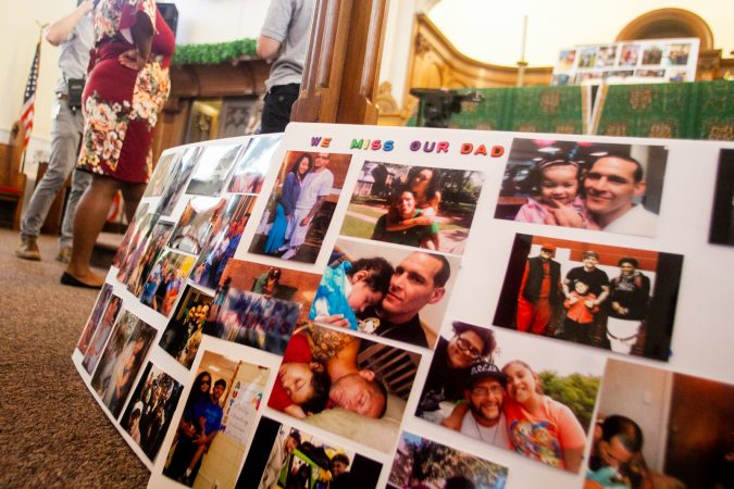 Photos of Joseph Santos and his family members were displayed at a memorial service last month for the 44-year-old who was fatally shot on July 28, 2018 by South Whitehall Township police officer Jonathan Roselle. (Brad Larrison for WHYY)