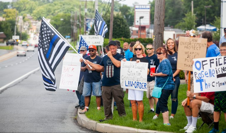Supporters of South Whitehall Township Police Officer Jonathan Roselle gathered on Hamilton Boulevard where he fatally shot Joseph Santos, 44, of Hasbrouck Heights, N.J. on July 28, 2018. (Brad Larrison for WHYY)