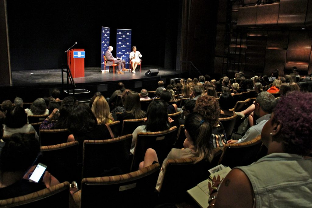 An audience fills the Suzanne Roberts Theater to hear the story of Tarana Burke, founder of the #MeToo movement.