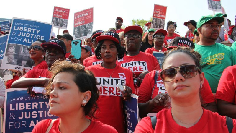 About 2,000 union members rally at the Great Plaza at Penn's Landing to protest U.S. treatment of immigrants. (Emma Lee/WHYY)