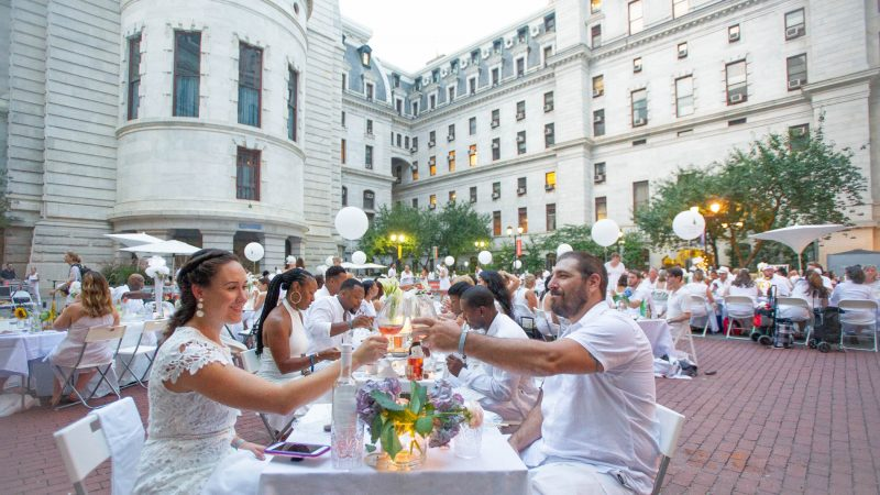 Gabrielle Salomone (left) and Chirs Passarella toast in City Hall courtyard. (Jonathan Wilson for WHYY)