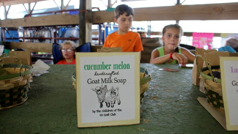 Children peddle the goat milk soap they made at the Middletown Grange Fair. (Emma Lee/WHYY)