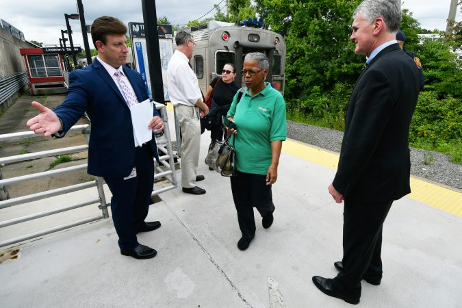 NJ Transit Executive Director Kevin Corbett (right) greets passengers returning from Atlantic City at the Lindenwold, N.J. station Tuesday. The agency held a listening forum for passengers to share their thoughts on the passenger rail service. (Bastiaan Slabbers for WHYY)