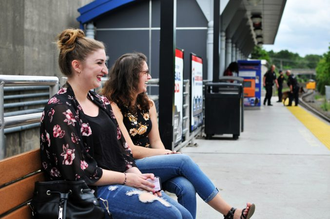 Jenna DeLuca waits with a friend for a train to Atlantic City Monday at the Lindenwold, N.J. station. (Bastiaan Slabbers for WHYY)