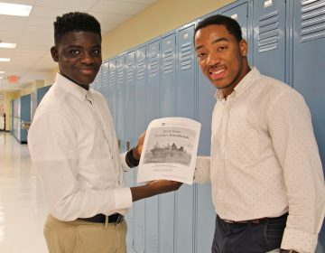 Science Leadership Academy students Khalid Abogourin (left), 17, and Horace Ryan III, 16, created a handbook for first year teachers that is being used in teacher orientations throughout the school district.