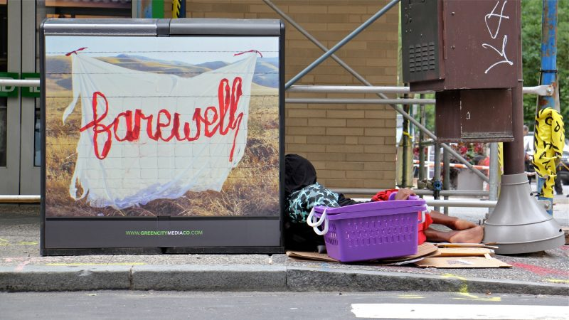 A silk graffiti work by Aubrie Costello adorns a trash can at 18th and Walnut streets. (Emma Lee/WHYY)
