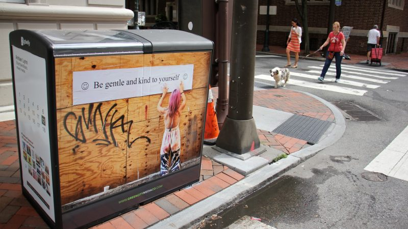 Amber Lynn's artwork graces a Bigbelly trash can at 17th and Locust streets. (Emma Lee/WHYY)