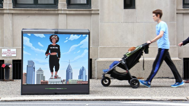 A digital illustration by Marisa Velázquez-Rivas is one of 18 art works used to displace advertisements on Bigbelly trash cans in and around Rittenhouse Square. (Emma Lee/WHYY)