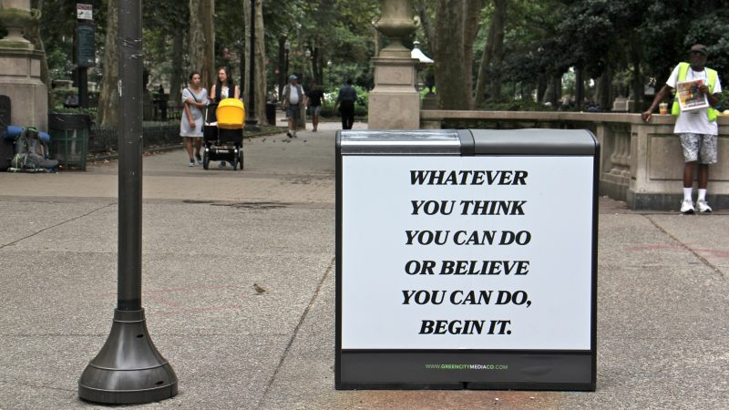 Saeed Ferguson's rendition of an inspirational quote stands out on a trash can at the entrance to Rittenhouse Square. (Emma Lee/WHYY)