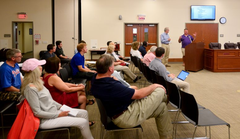 Consultant Thomas Frawley and developer Manny DeMutis present plans for the extension of rail commuter service from Philadelphia to Phoenixville, at a borough meeting in Phoenixville, PA, on August 21, 2018. (Bastiaan Slabbers for WHYY)