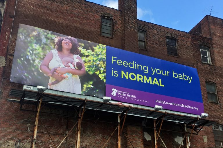 A billboard on Callowhill Street is part of Philadelphia's campaign in support of breastfeeding features a photo taken by Vanessa A. Simmons of a city woman. (Emma Lee/WHYY)