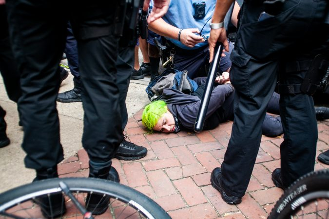 A protestor is arrested by Philadelphia Police during a scuffle that broke out on Race Street between Antifa protestors and the police. (Brad Larrison for WHYY)