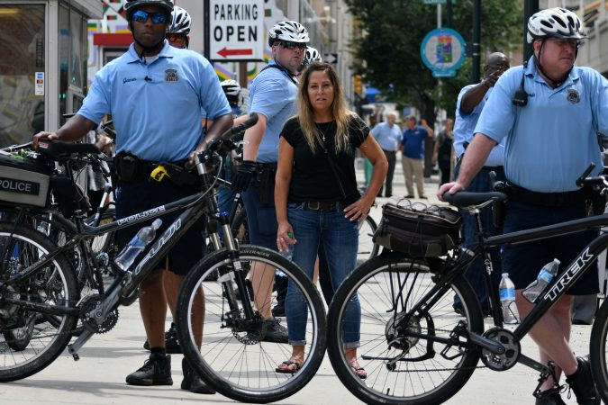 Participant in a Blue Lives Matter march watches from behind a bike line at Broad and Arch Streets, on Saturday. (Bastiaan Slabbers for WHYY)