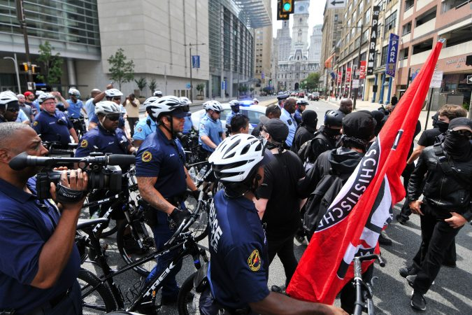 Police come between counter-protestors (on the right) and a Blue Lives Matter march, as it attempts to cross over Broad Street, towards Logan Square, on Saturday. (Bastiaan Slabbers for WHYY)