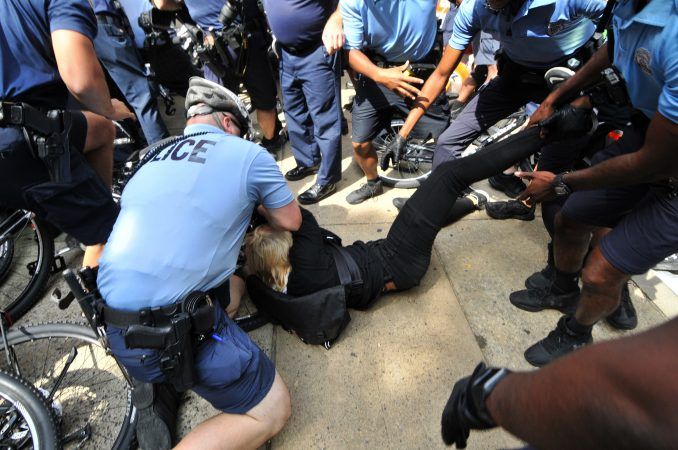 Police officers and counter-protestors clash as a small group of Blue Lives Matter protestors attempts to march in Center City, on Saturday. (Bastiaan Slabbers for WHYY)