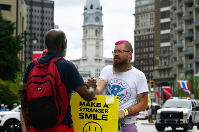 Activist Joe Cox stands on the Ben Franklin Parkway as a small group of Blue Lives Matter protestors attempts to march in Center City on Saturday. (Bastiaan Slabbers for WHYY)