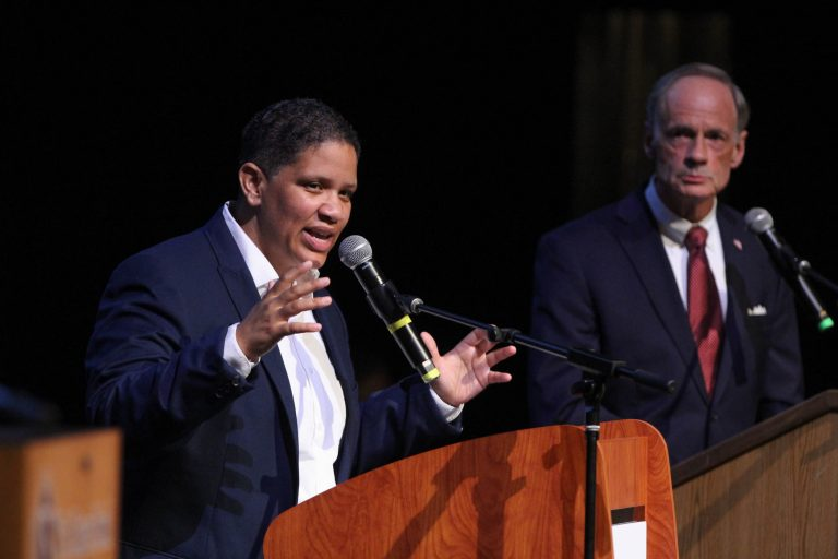 Incumbent U.S. Sen. Tom Carper (right) and challenger for the Democratic nomination, Kerri Evelyn Harris, debate at the Cab Calloway School for the Arts in Wilmington.