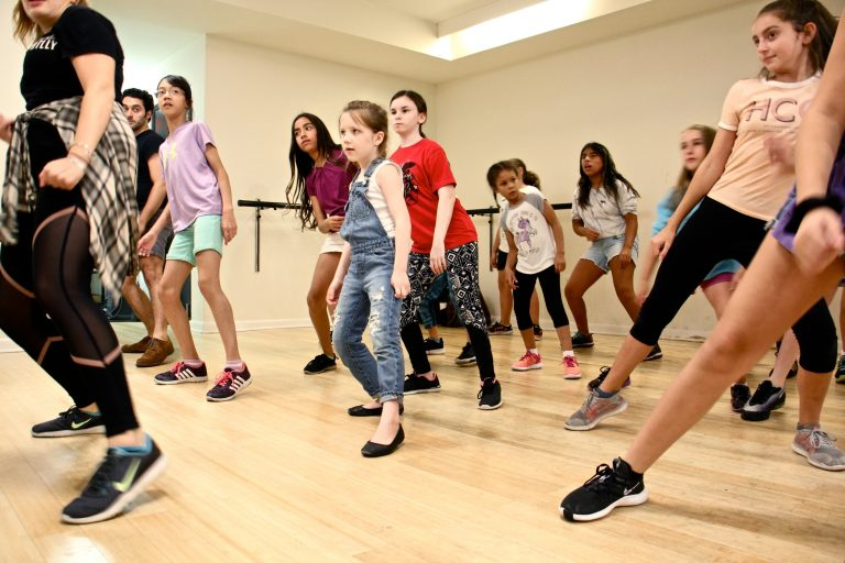 Young students work on a dance number during Hamilton Camp at Music Theatre Philly.